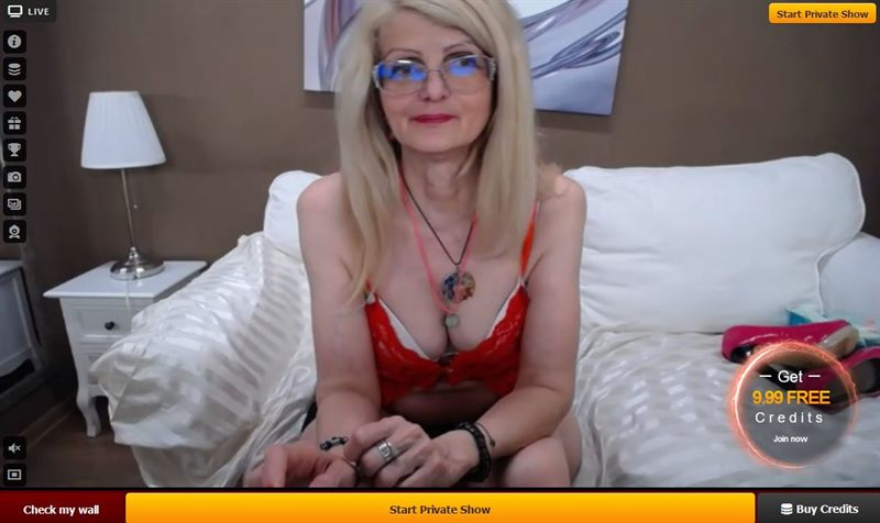A seasoned blonde MILF in a sexy red cammy on LiveJasmin.com